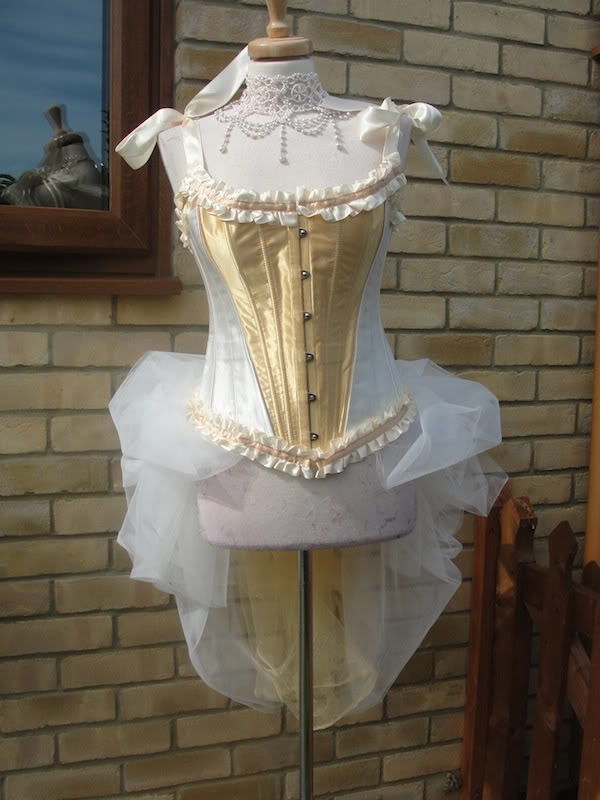 white amp gold corset with tulle bustle